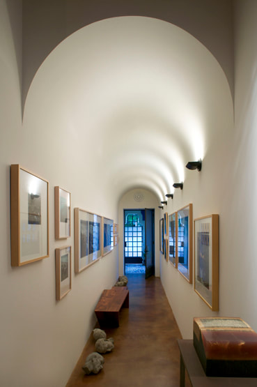 Indirect lighting features barrel vault while illuminating the art.